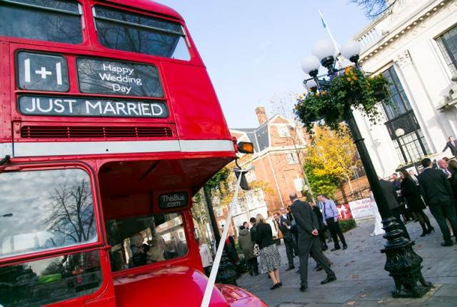 Vintage wedding featured on The National Vintage Wedding Fair blog red London bus