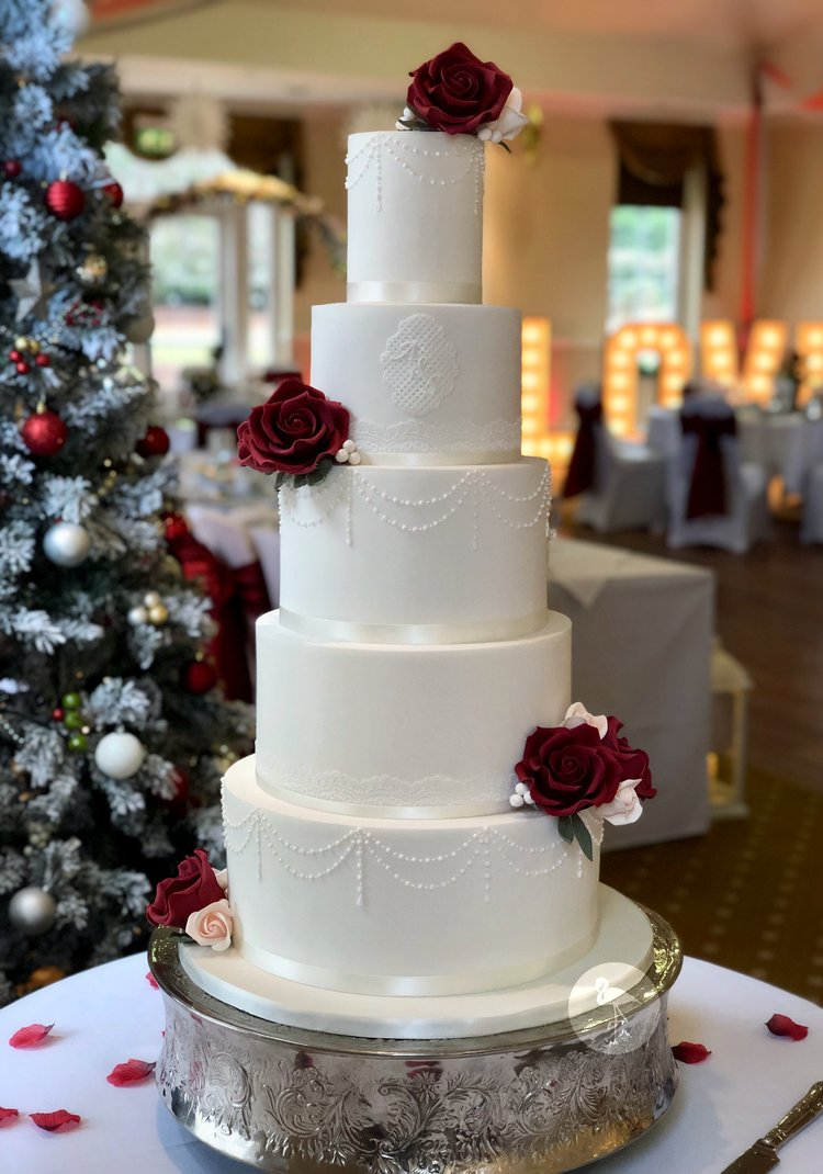 White and Red Festive Wedding Cake
