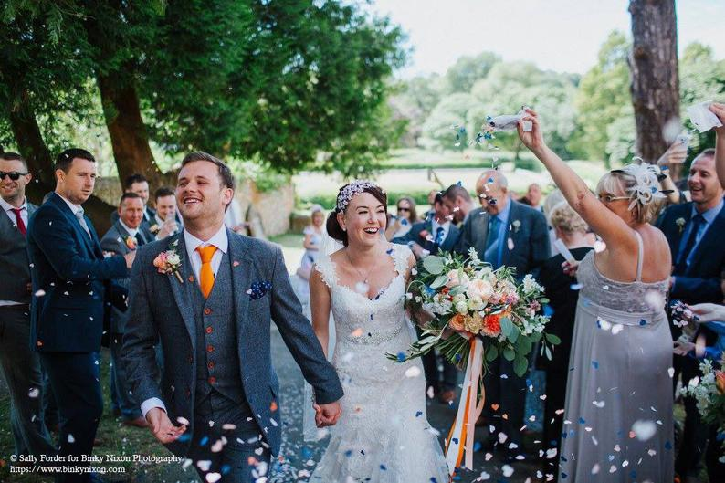 Bride and Groom Being Showered In Biodegradable Blush Grey & Ivory Wedding Confetti