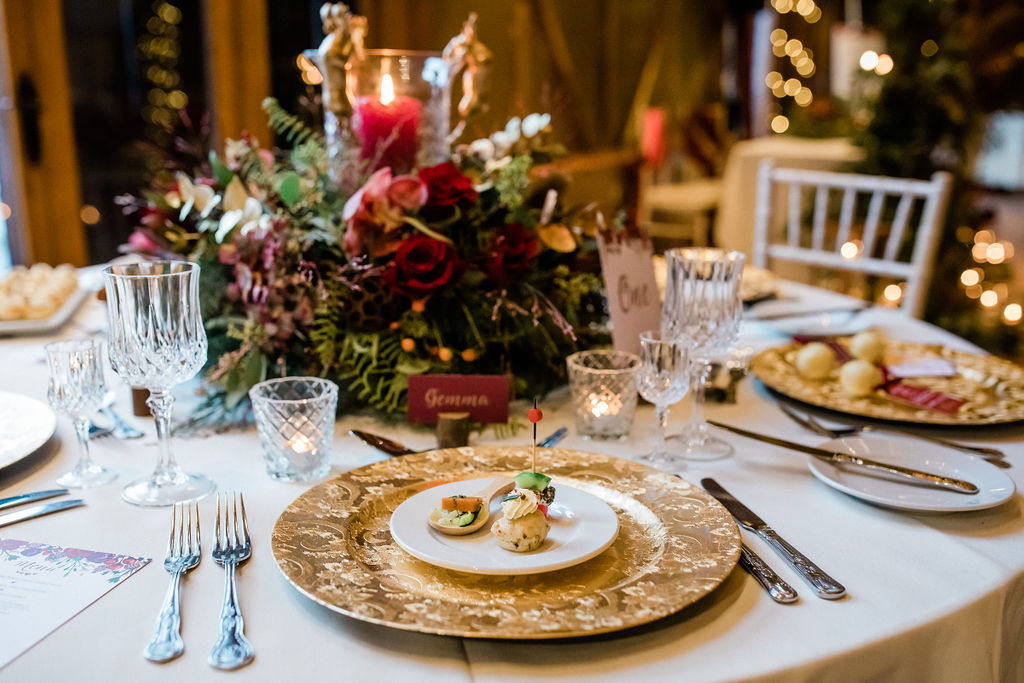 A Red and Gold Christmas Wedding With The Perfect Dinner Table At The Hundred House, Shropshire