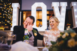 Bride and groom laugh to tears at their winter wedding speeches