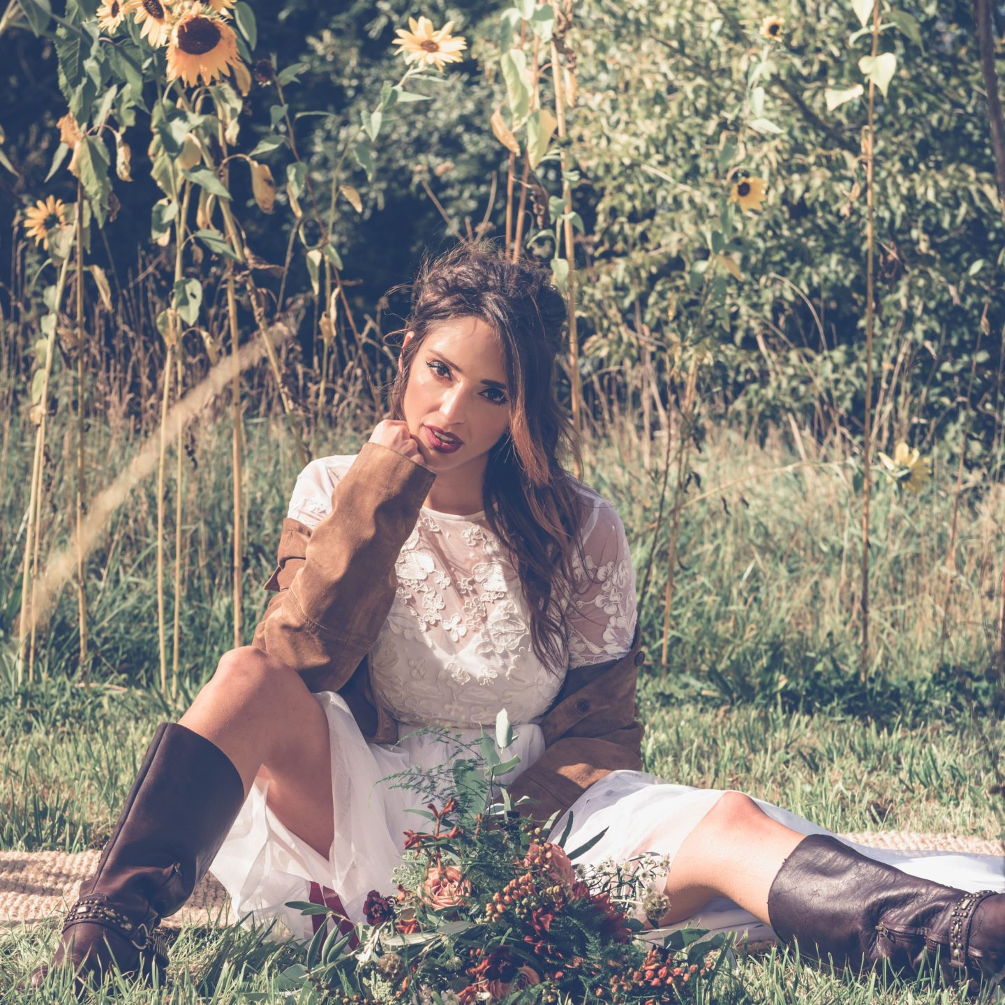 1970s Bohemian Bridal Inspiration With Field Flower Bouquets Cowboy Boots and Suede Jackets